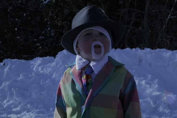 A little boy gets all dressed up as Don Cherry.