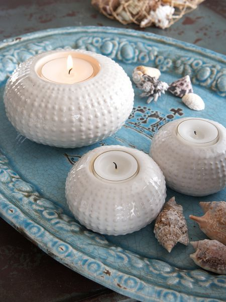 Add a coastal feel to any dinner table with these off-white ceramic sea urchin tea light holders.