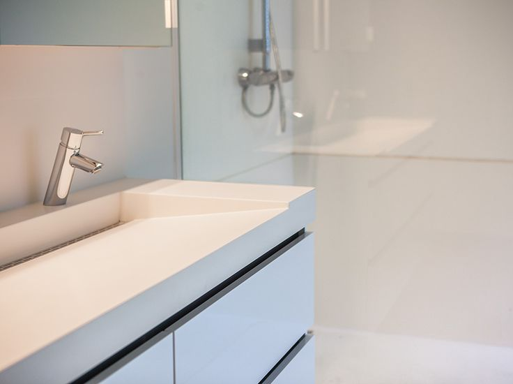 Matching finish of wash basin and shower space. Created by Assenti