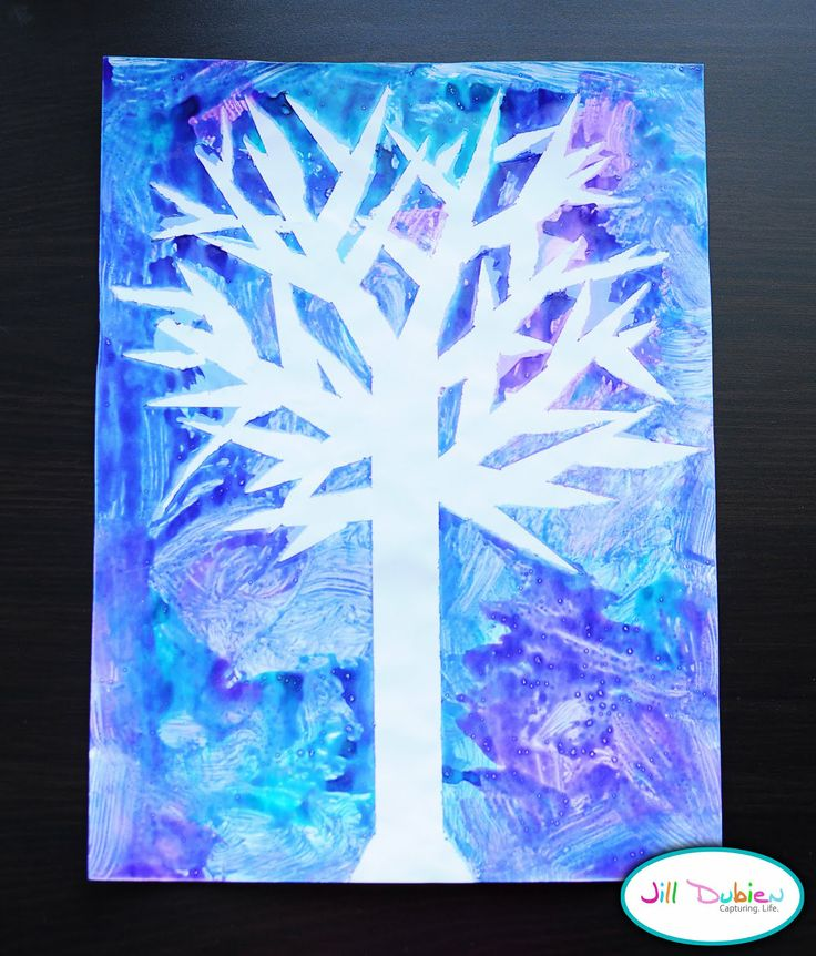 winter tree silhouette- put painter's tape on a paper in a tree design, paint over it, then peel it off