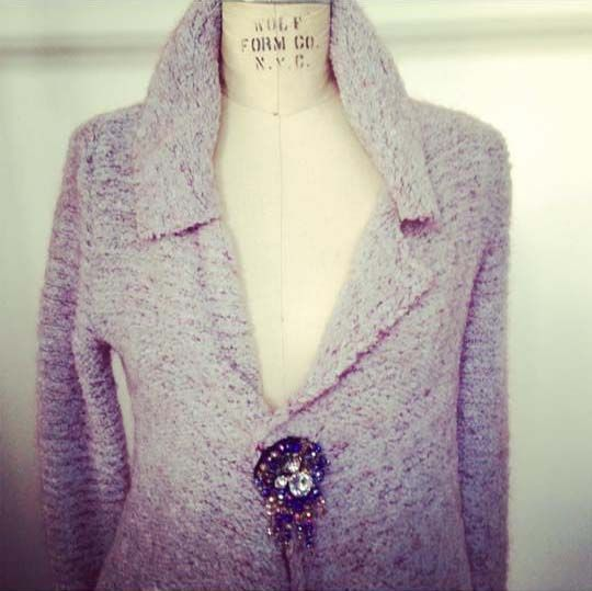 knitwear with jewellery button