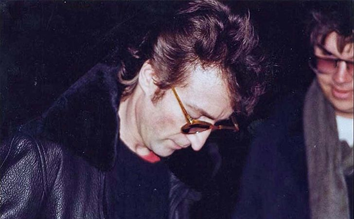Musical legend John Lennon's death came as quite an unexpected shock for a nation in the midst of the pop music craze. This picture shows him signing an autograph of his album Double Fantasy for Mark David Chapman, mere hours before he shot and killed him.