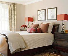 Warm Palette With a generously proportioned sleigh bed and high bombe chests, this bedroom becomes a well-appointed gentleman's retreat. A classic rug and vintage photographs add to the masculine appeal. But lush linens and fresh flowers make the room attractive to everyone. Why We Love It: With just a couple well-chosen pieces of large furniture, this small room makes a big style statement