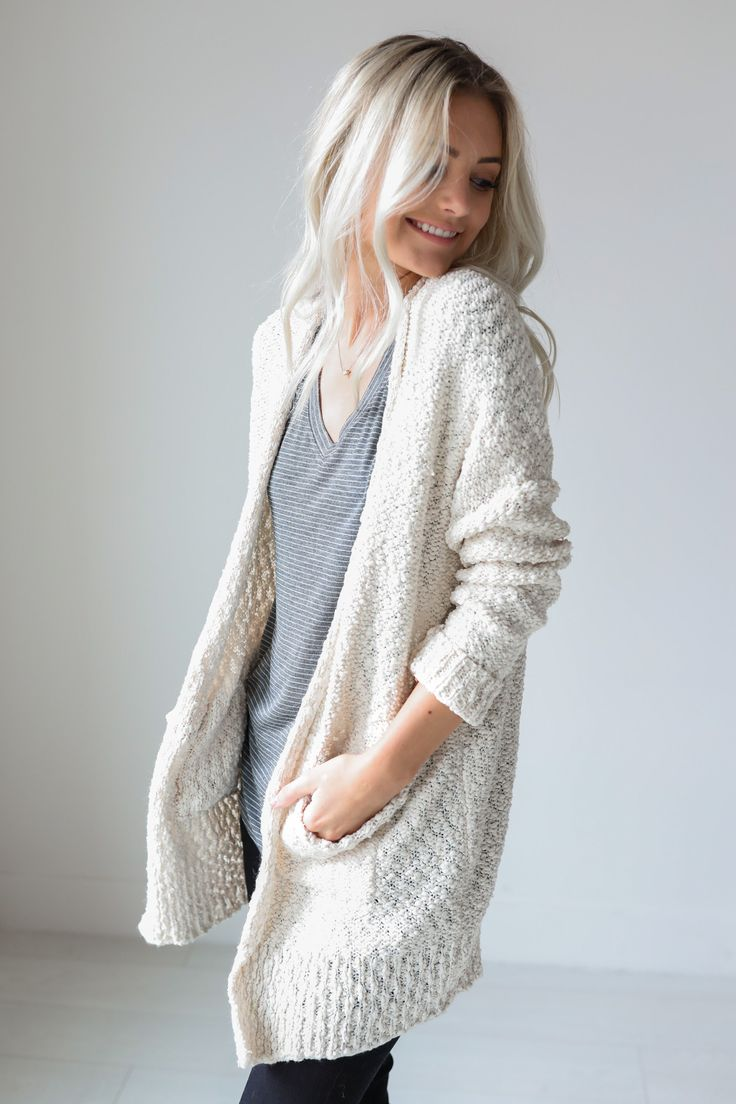 "• Cream thick knitted cardigan with pockets • Available in S/M and M/L. Model is 5' 4"" and wearing a size S/M • 55% Cotton, 45% Acrylic"