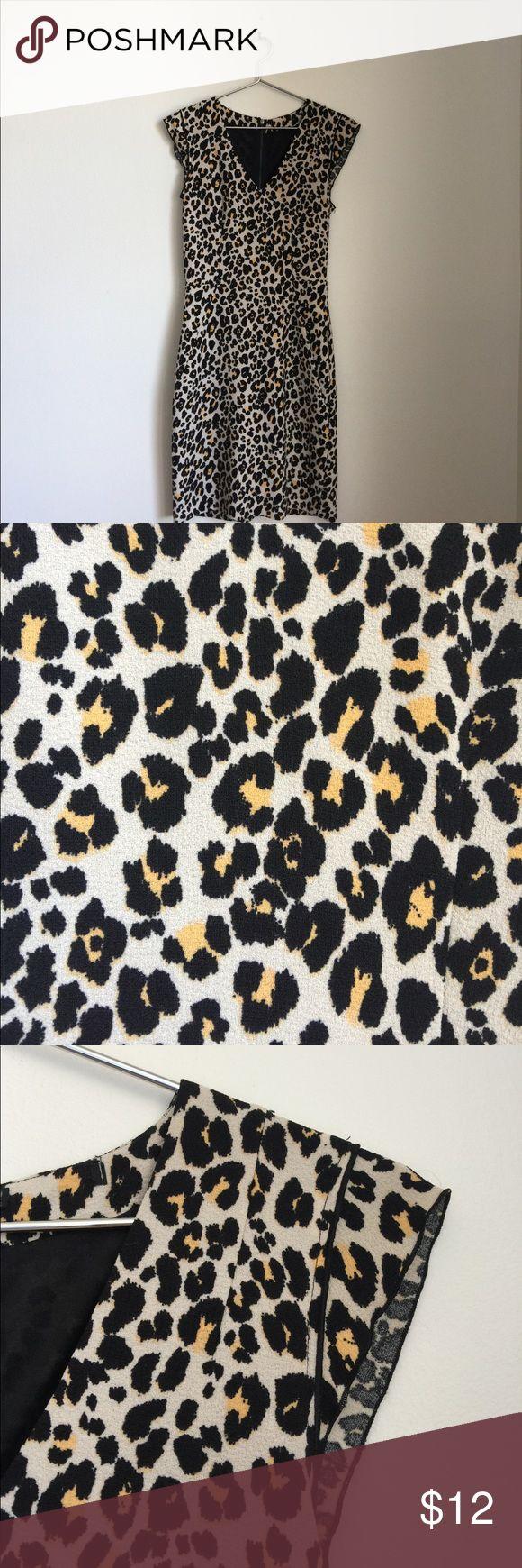 Panther print in crêpe stretch mini dress Panther print in crêpe stretch mini dress. In Creme black and yellow H&M Dresses Mini