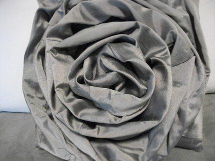 Here's a great DIY that also includes repurposing! Take an old skirt and turn it into a rose embellished pillow.