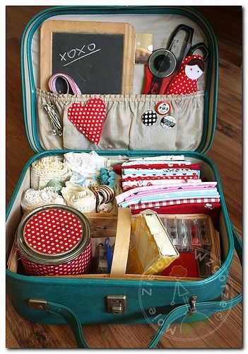 "While this vintage suitcase holds sewing supplies, thinking I could use multiple cases for various ""grab & go"" things - like road trips, dog park outings, winter prep - then just stack them all w/ hang tags. Would be pretty, functional & organizational all at once : )"