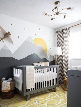 A modern nursery that makes great use of wall art and simple colours to transform the room.
