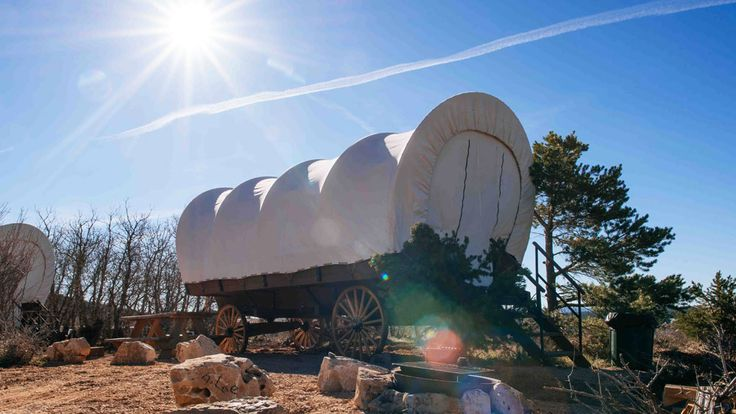 Families love Connestoga Wagons at Zion Ponderosa Ranch Resort! A true wild west camping experience near Zion National Park. Sleeps 6, 1 King, 2 twin/twin bunk beds, includes breakfast.