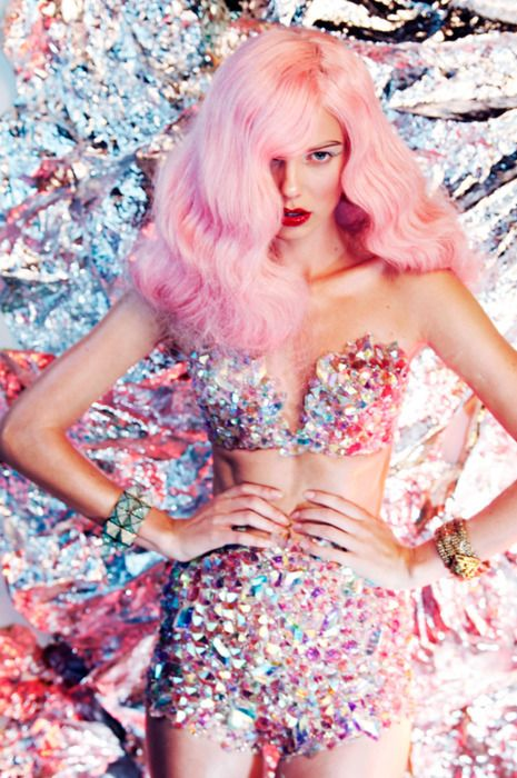 Gabriela Gomez Hirsch saved this photo titled 'Disco queen' to their StyleSaint profile. More than 52 StyleSaints retore this image. Silver sequined bra and shorts, pink hair, aluminum background, rose​.
