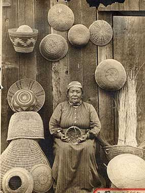 c. 1900 Native American woman surrounded by Modoc and Klamath baskets. Indian art of Oregon.