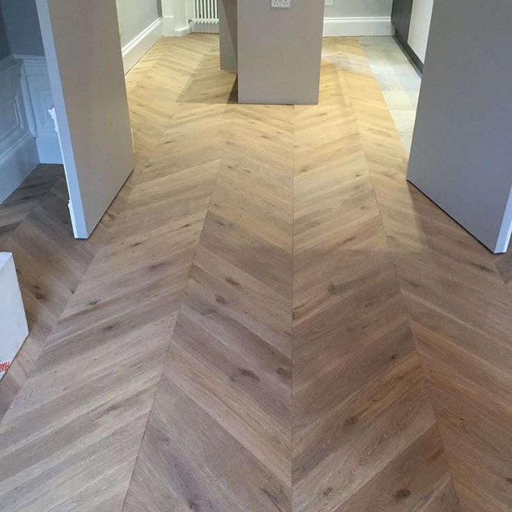 Silver Grey. Engineered oak chevron parquet flooring. Produced, supplied and professionally fitted. Unique Bespoke Wood  www.ubwood.co.uk #chevronparquet #woodenfloors #parquet #engineeredwoodflooring #interiorsUK #architectureUK #architecture #uniquebespokewood