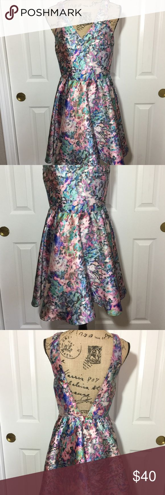 Rory Beca dress Small Beautiful multi color dress with deep V-on back.perfect to dress up or down.  EUC Rory Beca Dresses