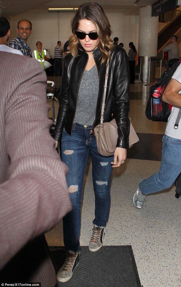 Edgy: Former pop princess Mandy Moore donned a black leather jacket and ripped jeans as she touched down to LAX on Friday