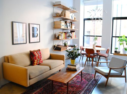 The traditional rug grounds this mid-century modern apartment.