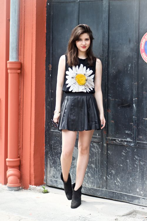 bright accents in an all-black outfit