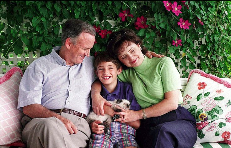 August 1997, John and Patsy Ramsey sit with their son, Burke, on their back porch in their home in Charlevoix, MI