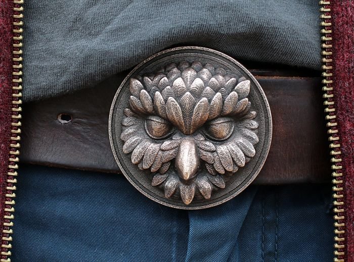 """I'm working on a series of belt buckles with animal characters.  This is the first one, called """"Owliver"""". New gang members will join soon.  What Owliver likes most about being an owl:  The night life,  moving like a ghost  and this distinguished and mysterious aura every owl is born with.  You could say """"creepy"""" and """"suspicious"""" instead, but in this case, you are obviously not a friend of owls!"""