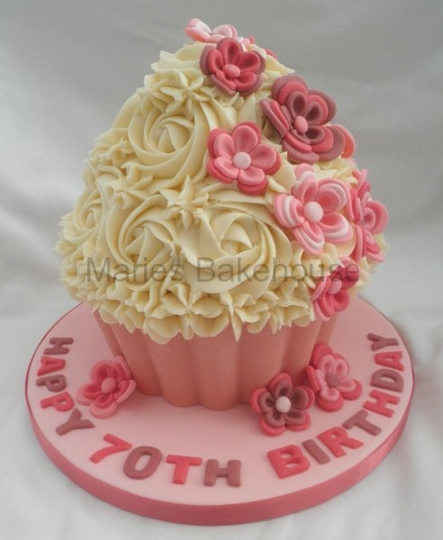 Vanilla giant cupcake in pinks for a 70th birthday for 70th birthday cake decoration ideas