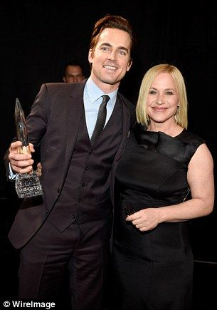 Boyhood: Matt Bomer proudly poses with his award (and Patricia Arquette)...