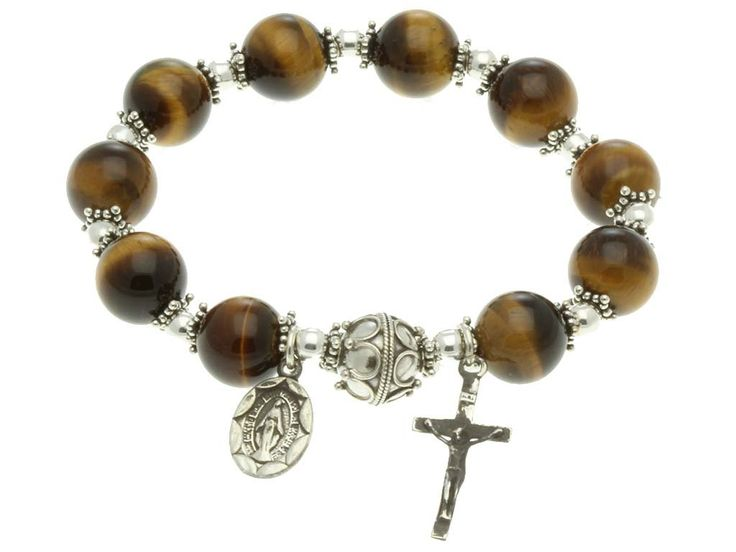 Sterling Silver Rosary, Tiger Eyes 10mm, Elastic Rosary Bracelet. Hand Craftly made with Stretch Magic cord, very resistant to the wear and tear. Antique Finished Sterling Silver Crucifix and a Miraculous medal. All our stone suppliers certify that to their best knowledge their stones, Pearls and Coral are not conflict ones. You could wear it and pray or you could just use it for praying with out wearing it. Elastic Bracelet, one size fit on everyone.