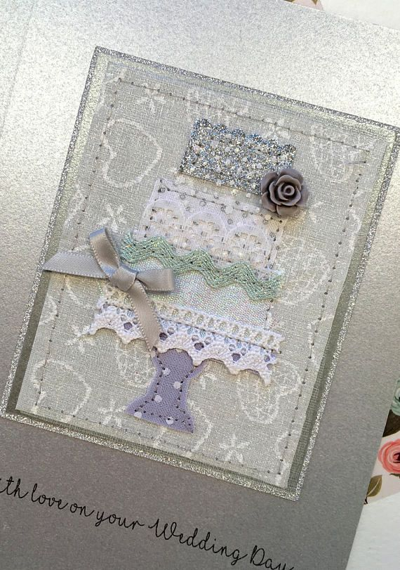 Handmade Wedding Card - Applique Fabric and Ribbon Wedding Cake A hand appliquéd Wedding Card for the Bride and Groom on their special day. All pieces of the cake are individually cut, placed and sewn to create this stunning card. Ribbons, fabric and embellishments used are all chosen