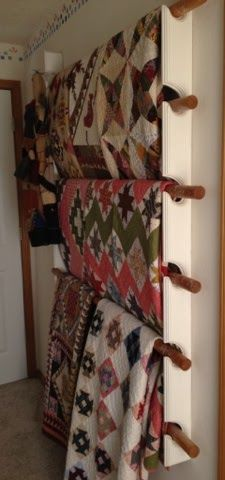 Lori from Humble Quilts blog. This is her quilt rack -  The rods are closet rods. You would only need to put in 3 rods unless the quilts you want to display are very small. These are not small quilts so I cannot fit quilts on each rod.