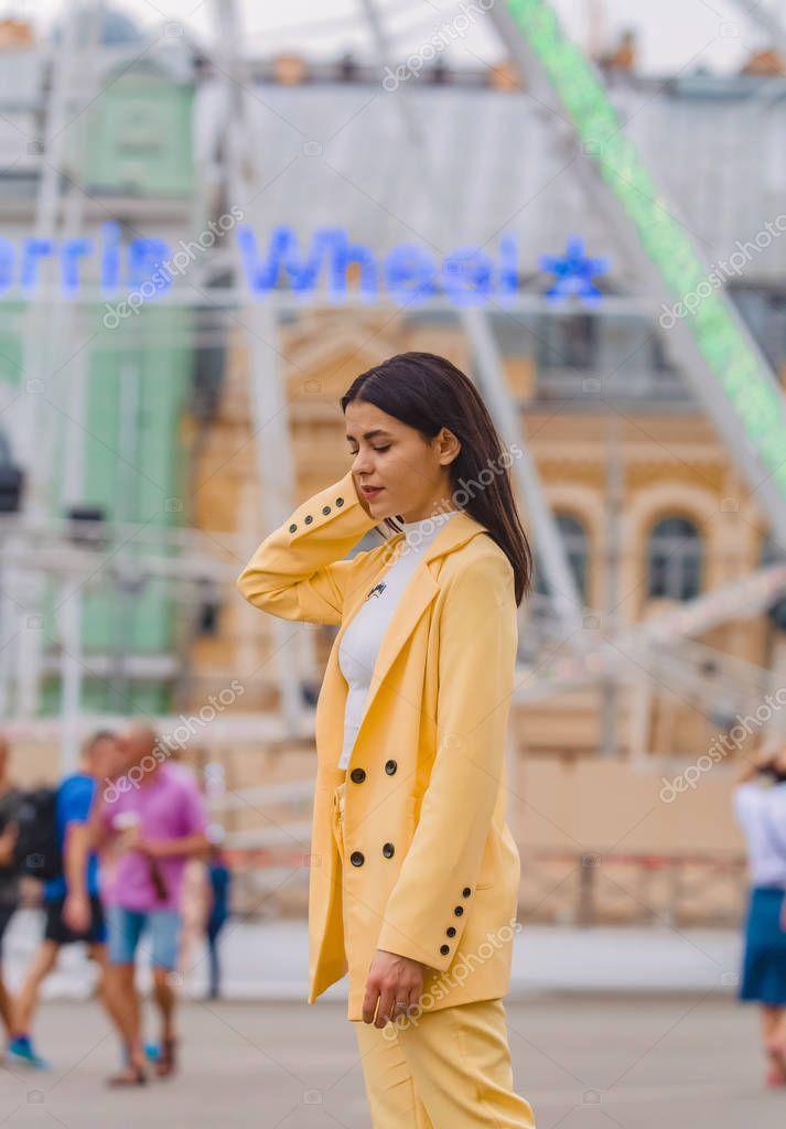 Young Stylish Girl Walks City Ferris Wheel Yellow Clasic Suit