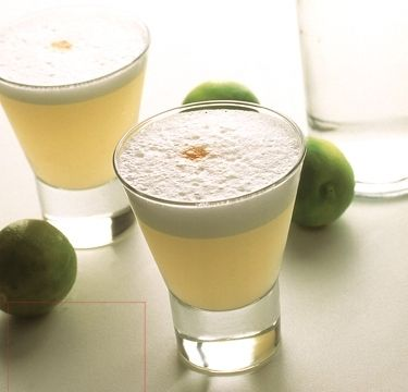 PISCO SOUR - 2oz Pisco / 1oz Lime juice / 3/4 fl oz Simple syrup / 1 Egg white / 1 dash Angostura Bitters - Shake hard or blend with ice and strain into glass. The bitters are an aromatic garnish topping the finished drink, put on top of pisco sour foam.
