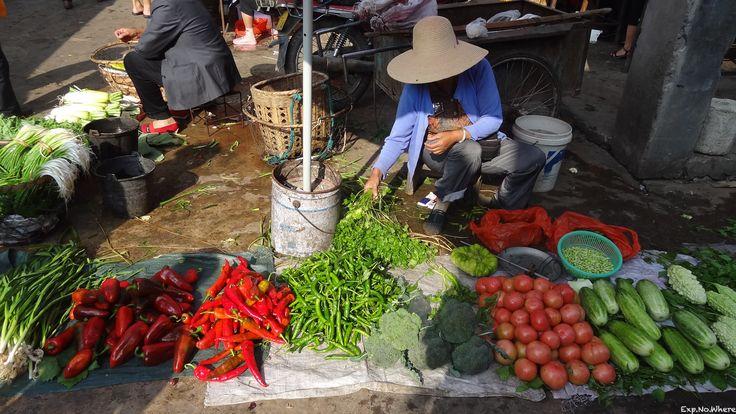 Farmer at the food market in Dali, China