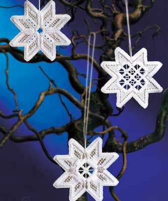 """NEW!    Create three lovely 3"""" Hardanger snowflakes with this complete kit from Permin Scandinavian Art Needlework.   The kit contains 22-count White Hardanger fabric, 100�0cotton thread, silver accent thread, needle, chart and instructions."""