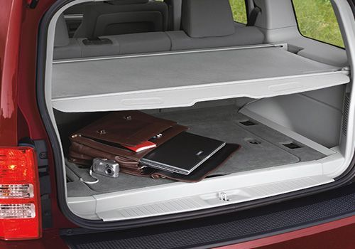 Why are accessories so expensive? Mopar OEM Jeep Patriot Cargo Area Security Cover.