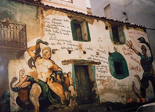 visit the city of orgosolo known for it's political murals