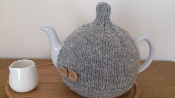 Grey hand knitted tea cosy with wooden button detail by DottyKnits