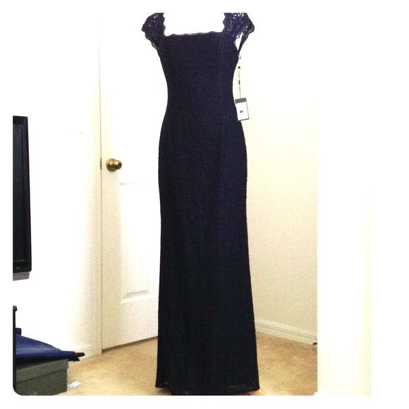 "NWT Open Back Lace Adrianna Pappel Navy Gown Never used with tags Adriana Pappel Lace Gown in Navy. Elegant and classy. Key hole back. Size 10. Dress has cap sleeves and hidden zipper in back. Fully lined. length: 59"" Slit in back. Adrianna Papell Dresses"