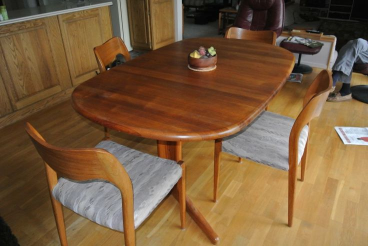 1980s Teak Dining Table - with extensions and 6 matching chairs (seat bottom cushions show wear)