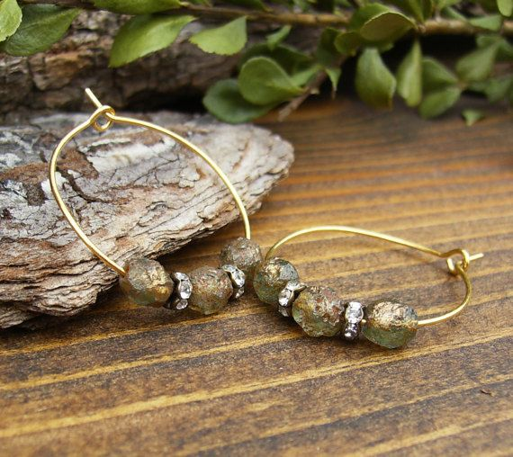 Gold Hoop Earrings, Rustic Green and Gold Picasso Czech Glass Hoops, Rhinestone and Gold Beaded Hoop Earrings, Sparkling Hoops, Gift Idea  Sparkling and rustic in one pretty earring. I started with watery green Czech glass pebbles - a textured surface shows off the metallic gold finish. Then I added sparkling rhinestone beads to contrast with the earthy effect of the Czech glass. The antique gold plated hoop ear wires are an inch in diameter - perfect for everyday wear. Overall a sparkling…