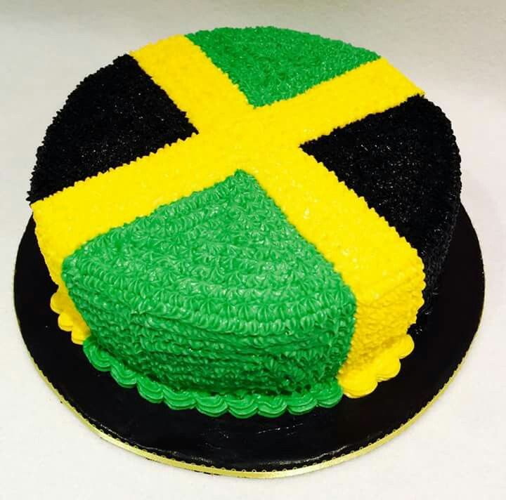 A decorative cake designed with the flag of Jamaica....The strength of the people