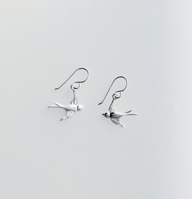 Sterling silver swallow earrings.