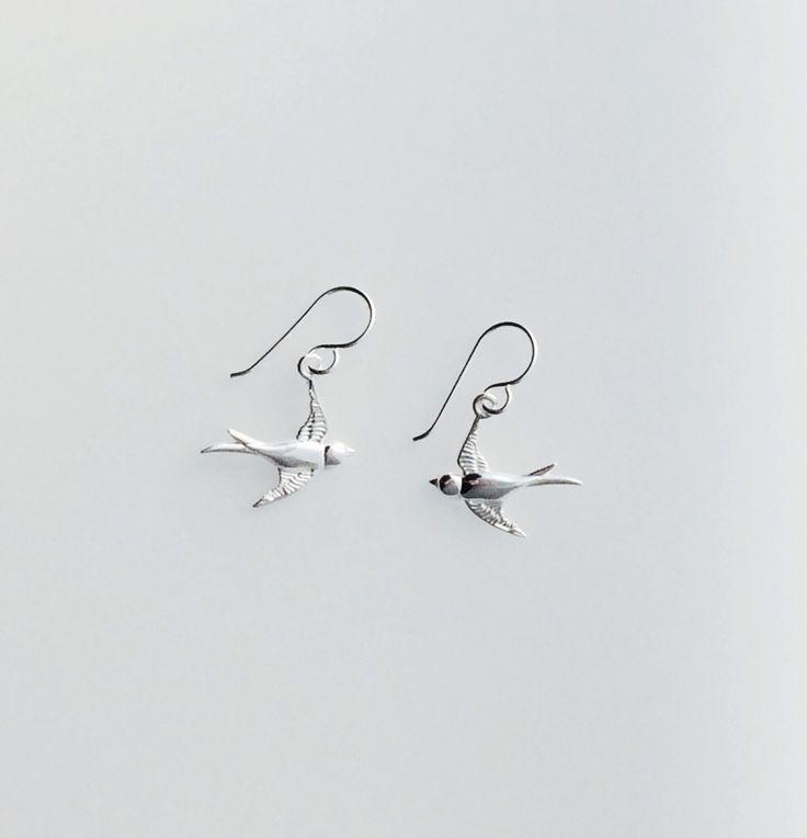 Sterling silver swallow earrings.