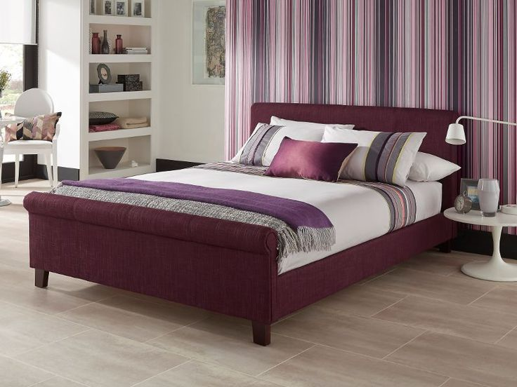 The Hazel bed frame upholstered in a plum coloured linen. The classically designed frame offers a stylish look for any bedroom and would compliment many interiors.