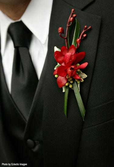 Sophisticated boutonniere of red mokara orchids!! Do you think most men would go for this design?  #boutonniere #red #orchid