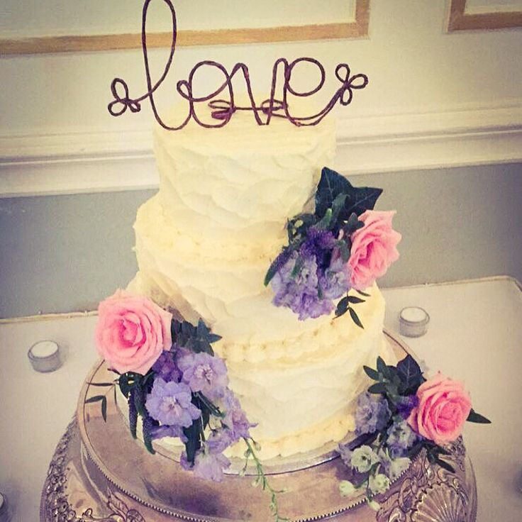 Rustic buttercream 3 tier cake with fresh flowers. Topper supplied by couple. www.kellylou.com