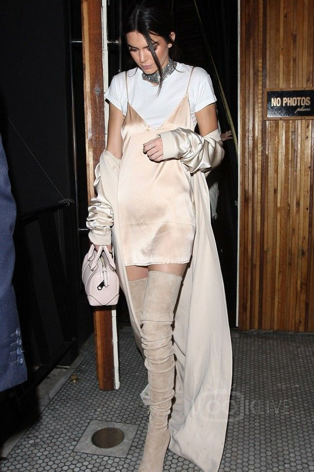 Kendall Jenner wearing  Are you am i  Zillah Slip Dress, August Getty Atelier SS16 Long Trench Coat in Silk Crepe, Givenchy Leather Micro Lucrezia Duffle Bag, Are you am i  Riley Baby Tee