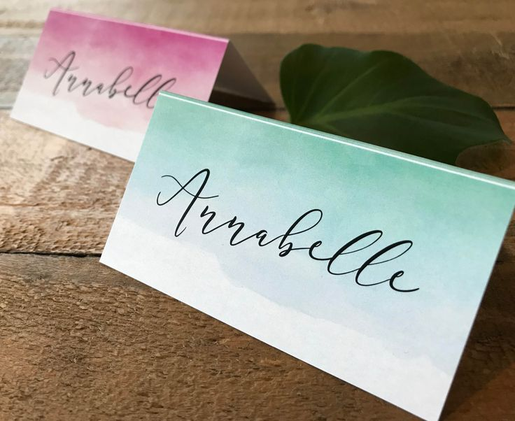 A set of gorgeous watercolor | watercolor place cards | tent cards | escort cards with an aqua | turquoise | blue or pink watercolour ombre background.