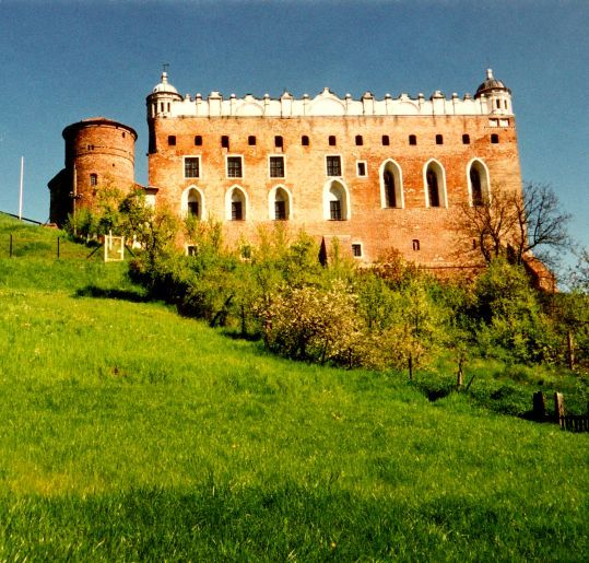 The Golub Castle in Golub-Dobrzyń. View from  Drwęca river valley.  The dome on the right blackened by a lightning strike. Photo taken a few years ago just before the renovation of the dome.