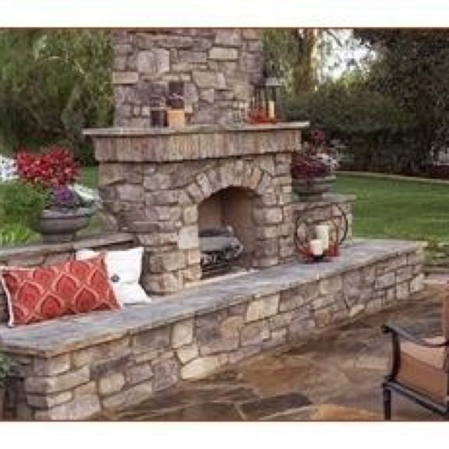 Outside fireplace - note slate flooring and I like the seating maybe curve rather than straight due to area