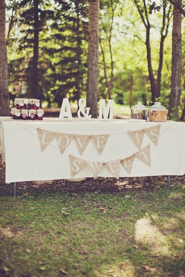 Love the banner and using initials as centerpiece - perfect table for a bridal shower