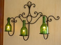 Elegant Three Candle Wine Bottle Iron Wall Sconce. yes, but don't like the bottles
