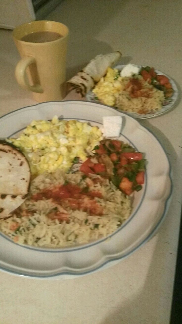 Start off a great morning with breakfast n coffee scramble eggs n tomato's, green peppers, n mushroom, n rice , n Spanish sauce, tortia on the side with feta cheese